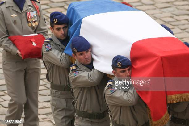 Soldiers carry the coffin of the 13 French soldiers who died in a helicopter collision in Mali during the tribute ceremony at the Invalides monument...