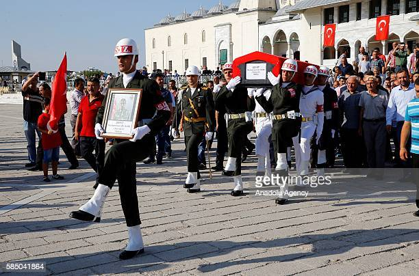 Soldiers carry the coffin of Turkish Special Operation Forces Commissioner Bulent Yurtseven who was critically wounded in airstrikes targeted the...
