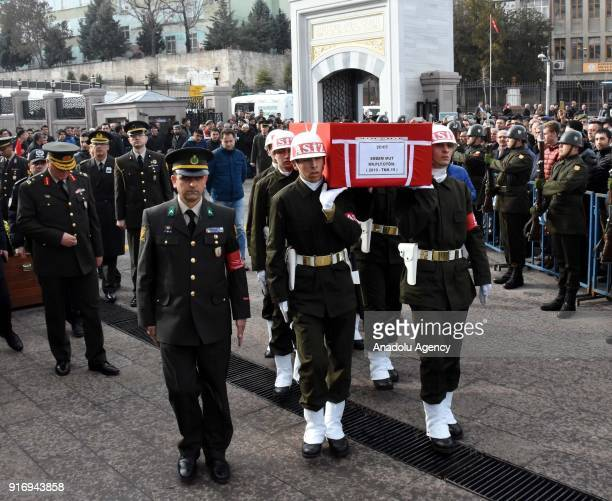 Soldiers carry the flagdraped coffin of First Lieutenant Erdem Mut who was martyred in a helicopter accident within the 'Operation Olive Branch' in...