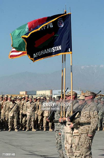 Soldiers carry the national flags of the United States and Afghanistan during a Memorial Day ceremony at Bagram air base, 50 kms north of Kabul, 28...