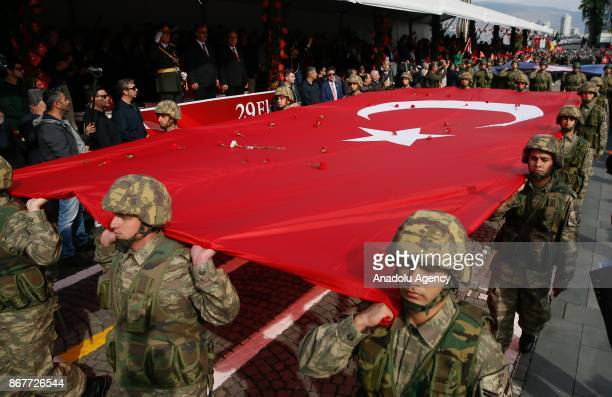 Soldiers carry the Turkish flag as they march during the celebrations for the 94th Anniversary of Republic Day at the Izmir Cumhuriyet Square in...