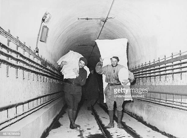 Soldiers carrying their bedding through a passageway on the Maginot Line France March 27 1940