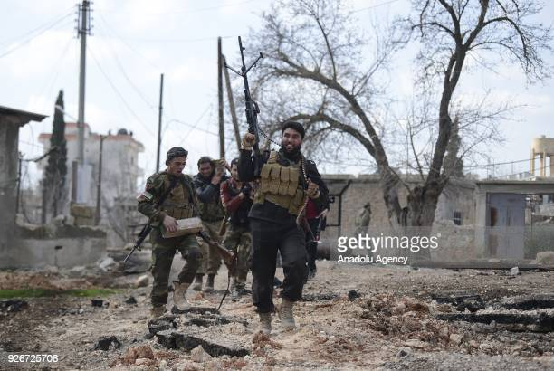 Soldiers celebrate after Free Syrian Army and Turkish Army cleared Ali Bazan Qariqin and Shamanli villages of Sharan district northeast of Afrin from...
