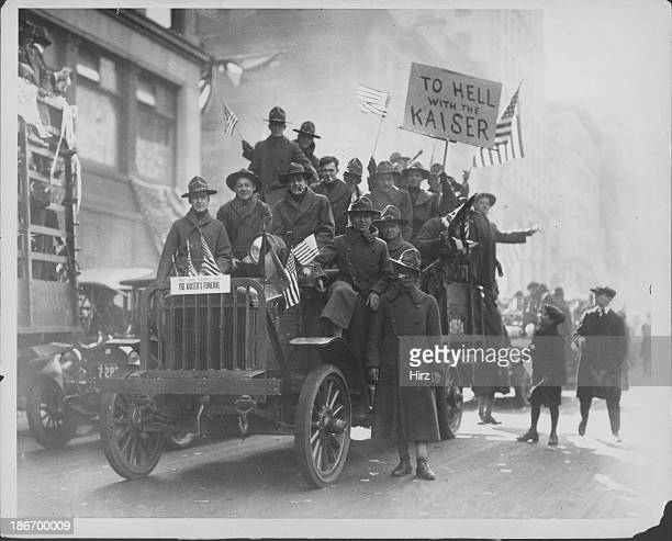 US soldiers celebrating on the back of an army truck in an Armistice Day Parade at the end of World War One New York City November 11th 1918