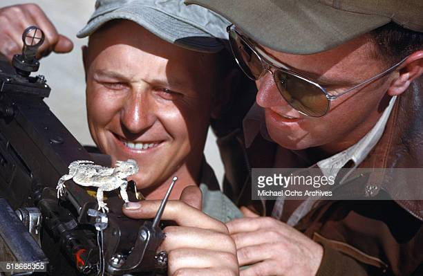 Soldiers check out a lizard at the flexible gunnery training at the Las Vegas Army Air Force Airfield in Las Vegas Nevada Circa 1942