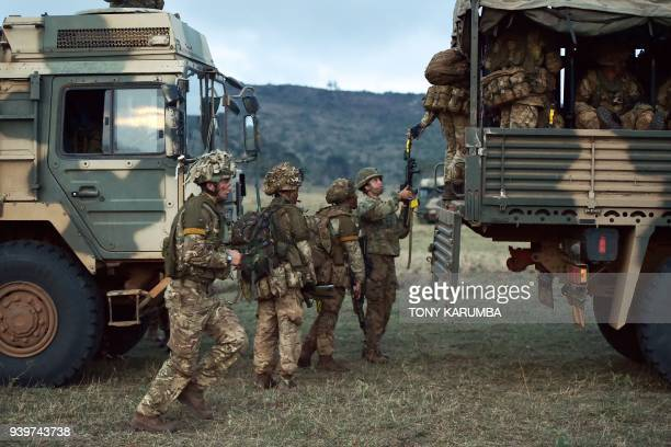 Soldiers climb into a military truck during a simulated military excercise of the British Army Training Unit in Kenya together with the Kenya Defence...