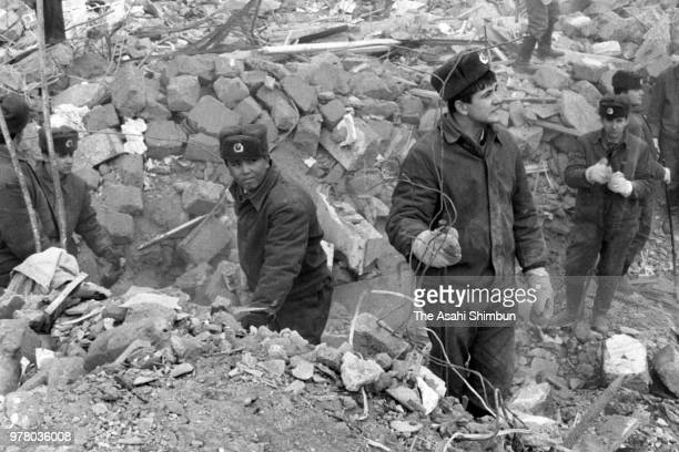 Soldiers continue searching operation in the rubble after a strong earthquake hit the region on December 17 1988 in Spitak Armenia Soviet Union