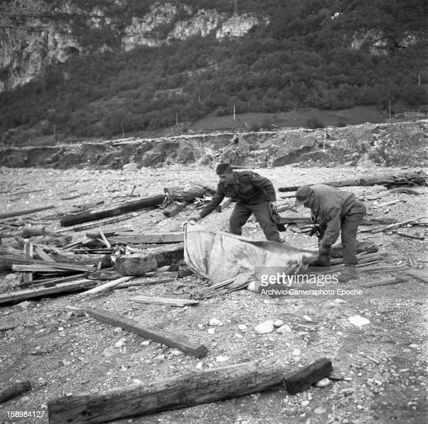 Soldiers cover corpses after the disaster Longarone near the Vajont Dam in the Piave Valley Italy early October 1963 On October 9 a landslide in the...