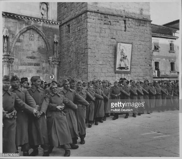 Soldiers dance a kolo to the Yugoslavian statesman Tito as part of a protest against the outcome of talks in London which had increased the level of...