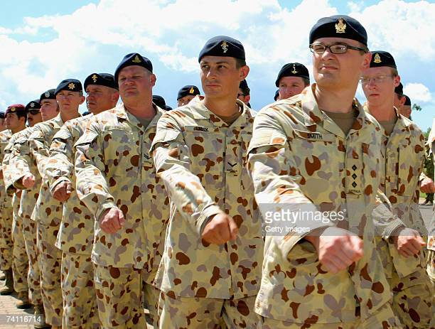 Soldiers deploying to Iraq march on to Robertson Barracks parade ground during a parade to farewell 450 Australian troops before their deployment to...