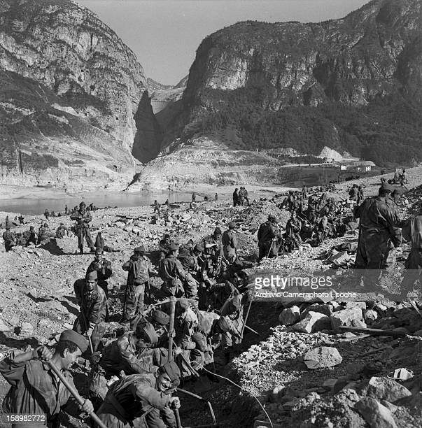 Soldiers dig through mud and rubble looking for survivors Longarone near the Vajont Dam in the Piave Valley Italy early October 1963 On October 9 a...
