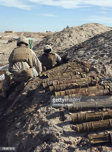 soldiers discover a weapons cache. - artillery stock pictures, royalty-free photos & images