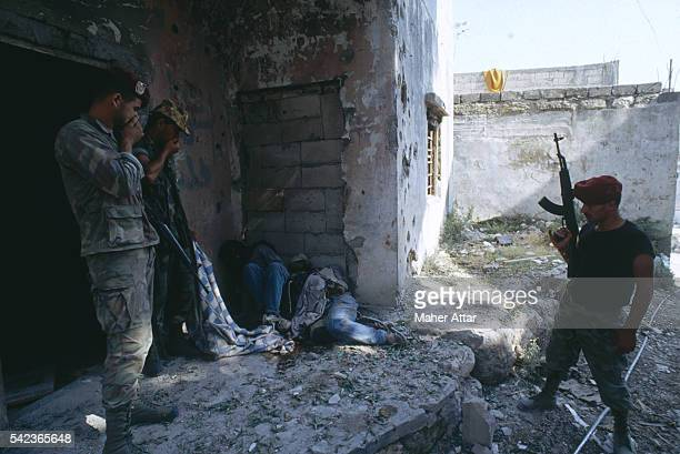 Soldiers discover dead bodies in the corner of a ruined house near the Ein El Helweh and MiyehMiyeh Camps