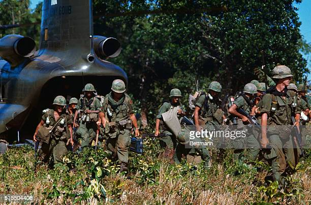 US soldiers disembarking from a troop transport helicopter in South Vietnam