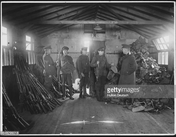 Soldiers dismissed at the end of the First World War hand in their guns and kit