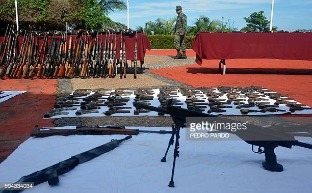 Soldiers display weapons seized during military operations to fight crime in Acapulco Guerrero State Mexico on August 22 2016 Guerrero is one of...