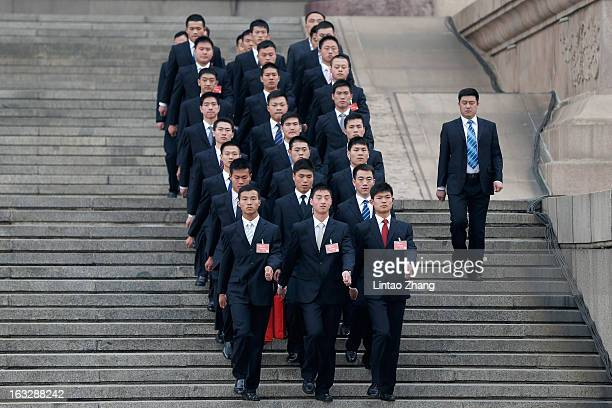 Soldiers dressed as ushers guard outside the Great Hall of the People after a plenary session of the Chinese People's Political Consultative...