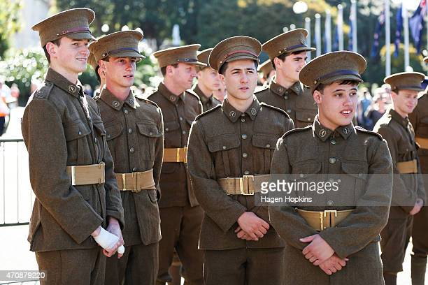 Soldiers dressed in WW1 replica uniforms look on during the Anzac Day eve street parade on April 24 2015 in Wellington New Zealand The parade was...