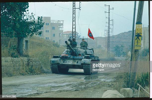 Soldiers drive a Sovietmanufactured tank down a muddy road during the Israeli invasion of Lebanon