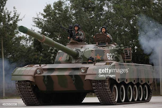 Soldiers drive a tank at the Academy of Armored Forces Engineering of the PLA on July 22 2014 in Beijing China As the Army Day draws near the...