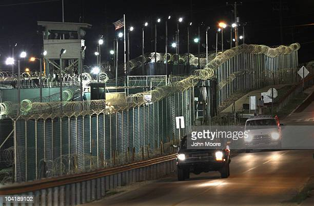 US soldiers drive along the perimeter of Camp Delta at the detention center for enemy combatants on September 16 2010 in Guantanamo Bay Cuba With...