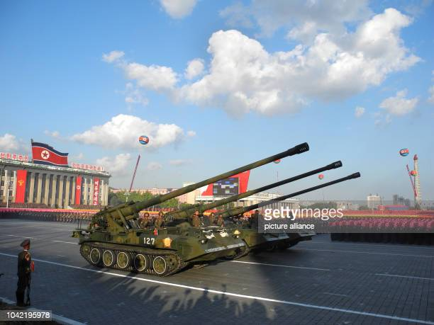 Soldiers drive heavy military equipment during the miltary parade for the 70th anniversary of the founding of the ruling workers' party on Kim Il...
