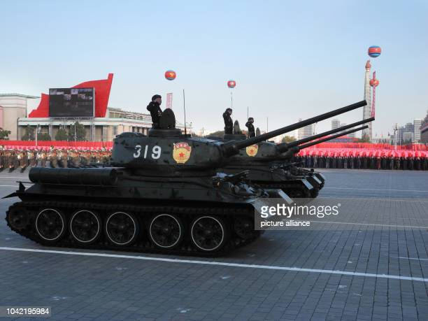 Soldiers drive heavy military equipment during the miltary parade for the 70th anniversary of the founding of the ruling workers' party on Kim...