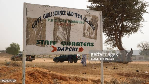 Soldiers drive past a signpost leading to the Government Girls Science and Technical College staff quarters in Dapchi Nigeria on February 22 2018...