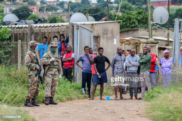 Soldiers during the handing over sanitisers, masks and sanitary packs in the Umlazi township on April 09, 2020 in Durban, South Africa. The...