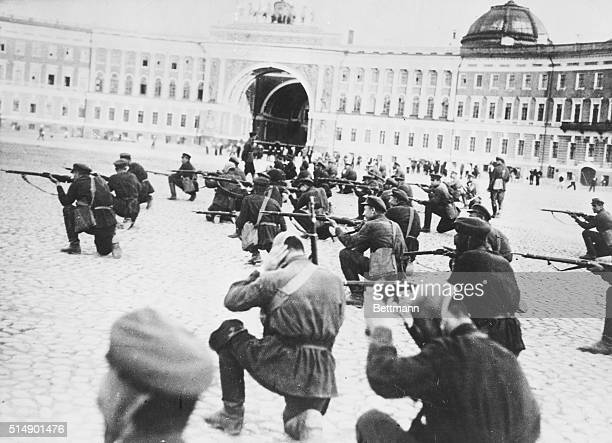 Soldiers during the Russian Revolution firing rifles in Palace Square