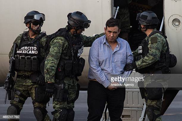 "Soldiers escort a man who authorities identified as Omar Trevino Morales, alias ""Z-42"", leader of the criminal group ""Los Zetas"", at the Attorney..."