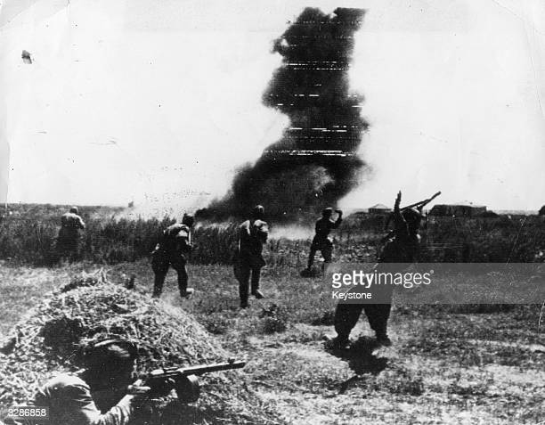 Soldiers face an explosion in the thick of the battle for Stalingrad One soldier has been hit by a sniper