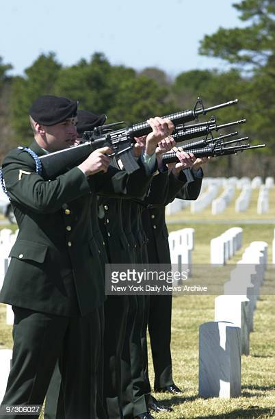 Soldiers fire a salute at Calverton National Cemetery where Army Sgt Michael Esposito Jr was buried today The 22yearold soldier was killed in a...