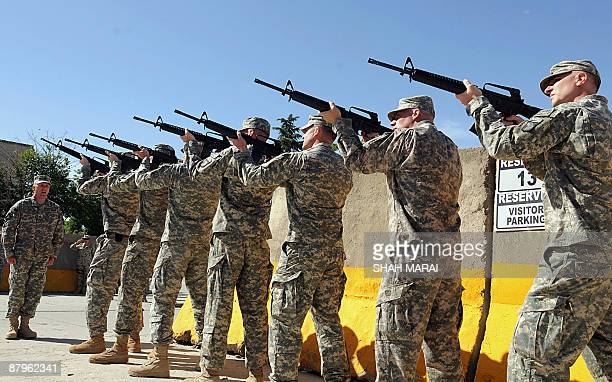 Soldiers fire during a ceremony at Bagram air base, about 50 kms north of Kabul on May 25, 2009. US forces based at Bagram air base gathered for an...