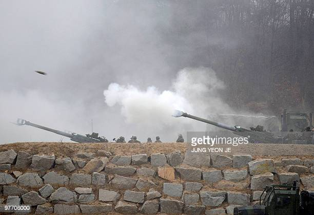 Soldiers fire M777 155mm howitzers during an annual joint military exercise at a shooting range in Pocheon near the Demilitarized Zone dividing the...