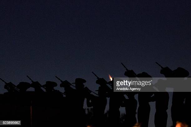 Soldiers fire rifles during the Anzac dawn service held at the Shrine of Remembrance on the 101st anniversary of the Australian and New Zealand Army...