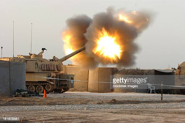 soldiers fire the howitzers on their m109a6 paladins. - iraq stock pictures, royalty-free photos & images