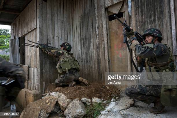 Soldiers firing at enemy positions while they try to clear the city of armed militants one street at a time on May 25 2017 in Marawi city southern...