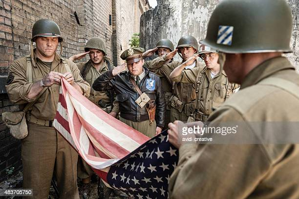 wwii soldiers folding flag ceremony - fallen soldier stock pictures, royalty-free photos & images