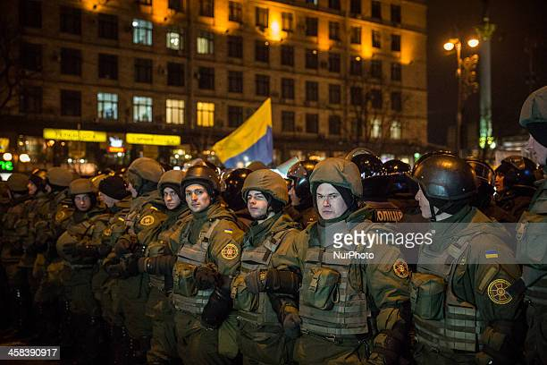 Soldiers form a barricade against protesters during a rally on Maidan Square in Kiev on November 21 on the third anniversary of the Euromaidan...
