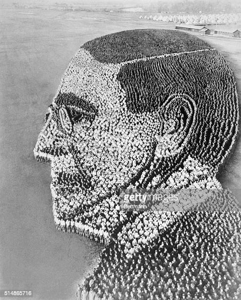 Soldiers form a profile of President Woodrow Wilson on the parade grounds at the United States Army's Camp Sherman. Arthur Mole designed the portrait...