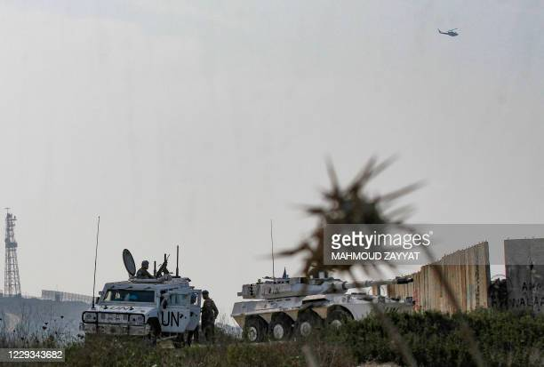 Soldiers form the Italian contingent with the UN Interim Force in Lebanon monitor the area near the southern Lebanese border town of Naqura on...