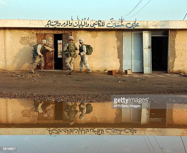 Soldiers from 1-8, 3rd Brigade, of the 4th Infantry Division search a store in the industrial section of Samarra, 17 December, 2003. A major...