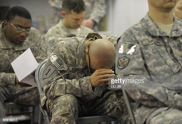 Soldiers from 1st Infantry Division pray during an Easter Sunday Mass at the Raider Chapel in ISAF's Camp Bostick in Naray, in the eastern Kunar...