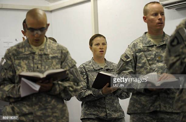 Soldiers from 1st Infantry Division sing during an Easter Sunday Mass at the Raider Chapel in ISAF's Camp Bostick in Naray, in the eastern Kunar...