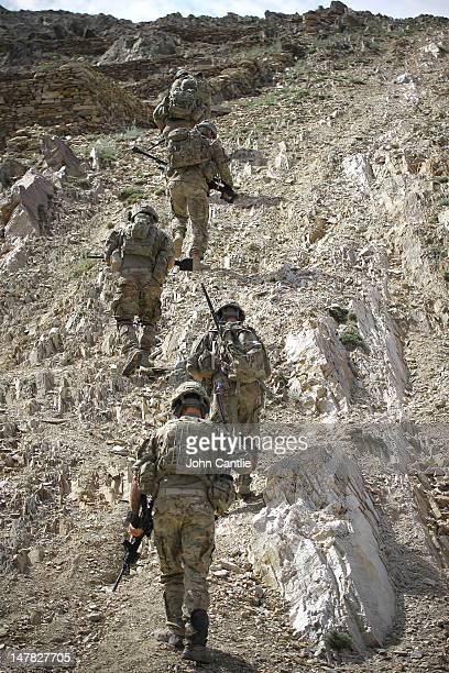US soldiers from 212 Infantry Regiment out of Colorado Springs ascend rocky terrain during a foot patrol on June 27 2012 in the Pech Valley...