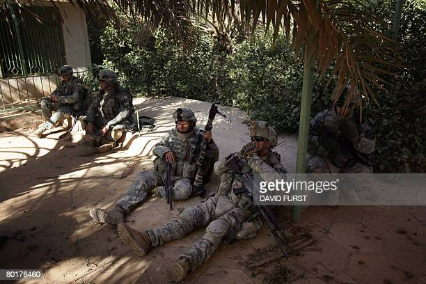US soldiers from 2nd Battalion 23rd Infantry Regiment take a break from a patrol in the restive Diyala province northeast of Baghdad on March 9 2008...