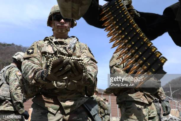 Soldiers from 2nd Infantry Division take part in the Best Warrior Competition at the Rodriguez Range on April 16, 2019 in Pocheon, South Korea. The...