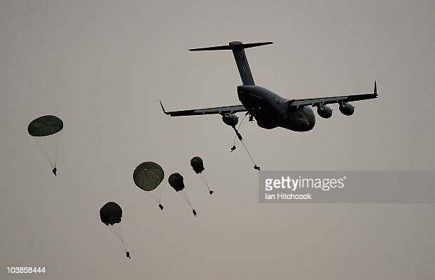 Soldiers from 3 RAR descend from parachutes during an airborne combat team exercise as part of a combined Arms training activity on September 6 2010...