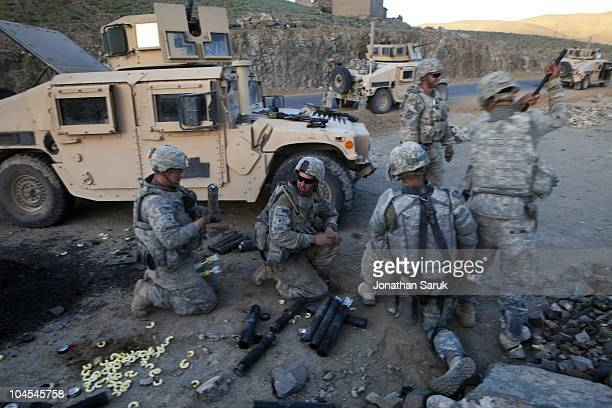US soldiers from 3rd Brigade 10th Mountain Division fire mortars at an enemy position after their convoy came under attack by insurgents May 25 2009...